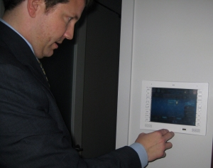 Steve Tedder shows the power of the control panel, affecting lighting, blinds, and audio visual components in the homes at The W Atlanta Downtown