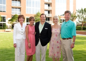 From left, Atlanta Fine Homes Sotheby's International Realty agents Kay Quigley, Suzanne Dils and Sam Bayne and Anne Schwall, senior vice president of the firm's Skyrise Group, and her husband Craig on The Brookwood's great lawn.