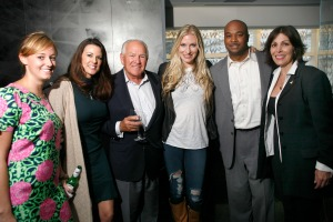 Joining Holly Williams, (fourth from left), at W Atlanta Residences, are, from left: W sales agents Natalie Ransom and Tracy Glass; W Residences developer Hal Barry; Atlanta City Councilman Kwanza Hall; and The Recording Academy's Michele Caplinger