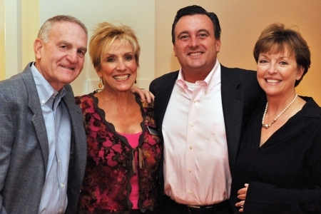 Sovereign Sales Associates Burma Weller and Kevin McBride are surrounded by Sovereign homeowners, Allen and Kay Salikof