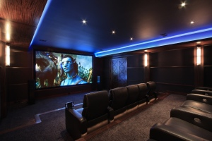 Two tiered Screening Room with German leather seating, mahogany walls and state of the art equipment by Macintosh